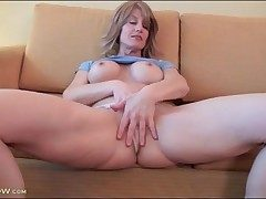 Lana Wilder models fake tits and wanks solo