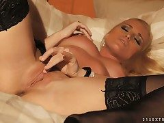 Glamourous insulting comme ci bitch Kathia Nobili is masturbating with meticulous stockings