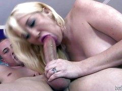 Imported blonde milf Alana Evans displays her sexy tits as A